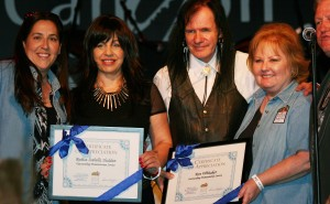 Rodica Isabella Shaldan and Ron Whitaker receive an appreciation certificate from Santa Clarita Food Pantry  at The Canyon Club during a performance at The Canyon Club © Bourgeois Magazine LA