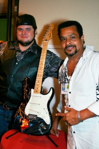 Boogie Long and Neal Hamilton pose with the guitar, during a premiere of We Are Kings. Copyright 2014 Bourgeois Magazine LA
